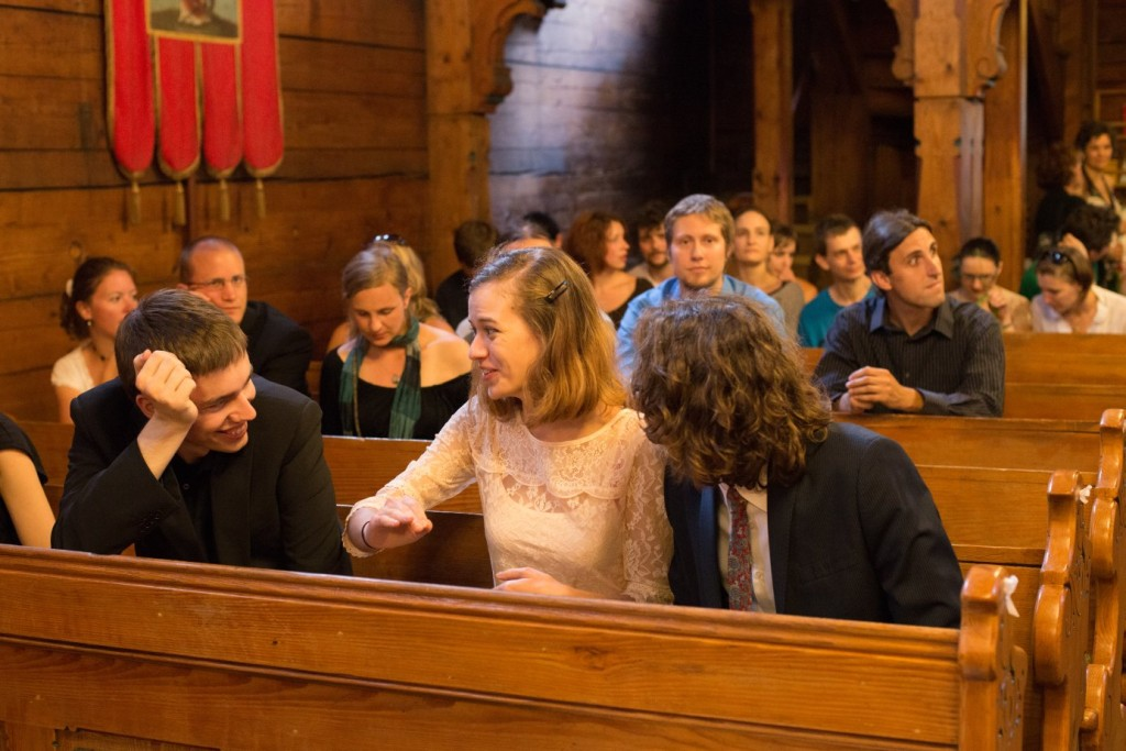 Image of people in wooden church